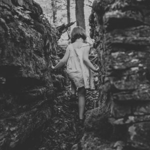 girl walking out of crevasse caves