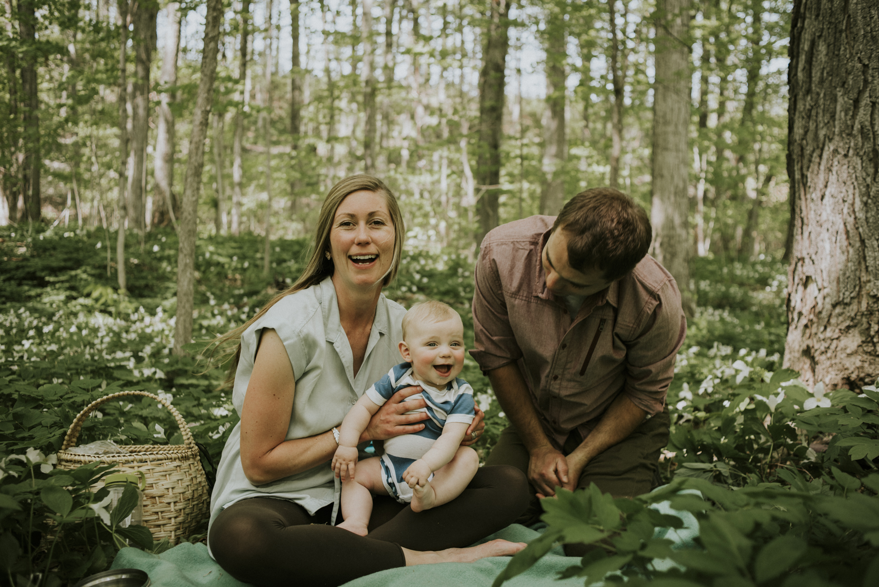 Family of three in Thornbury forest, Ontario.
