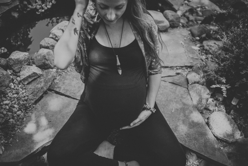 Pregnant Woman outside in the garden. Black and white.
