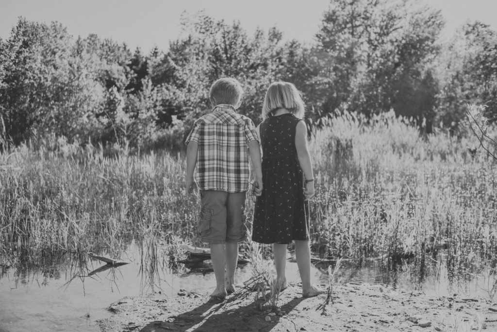 Brother and Sister looking at a pond. By Family Photographer Sarah Tacoma.