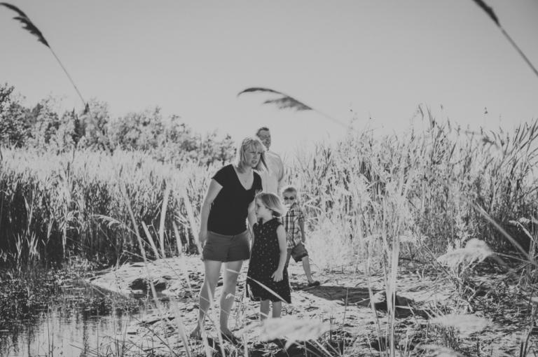 Family walking at Georgian Bay Beach.  Family Photography by Sarah Tacoma.