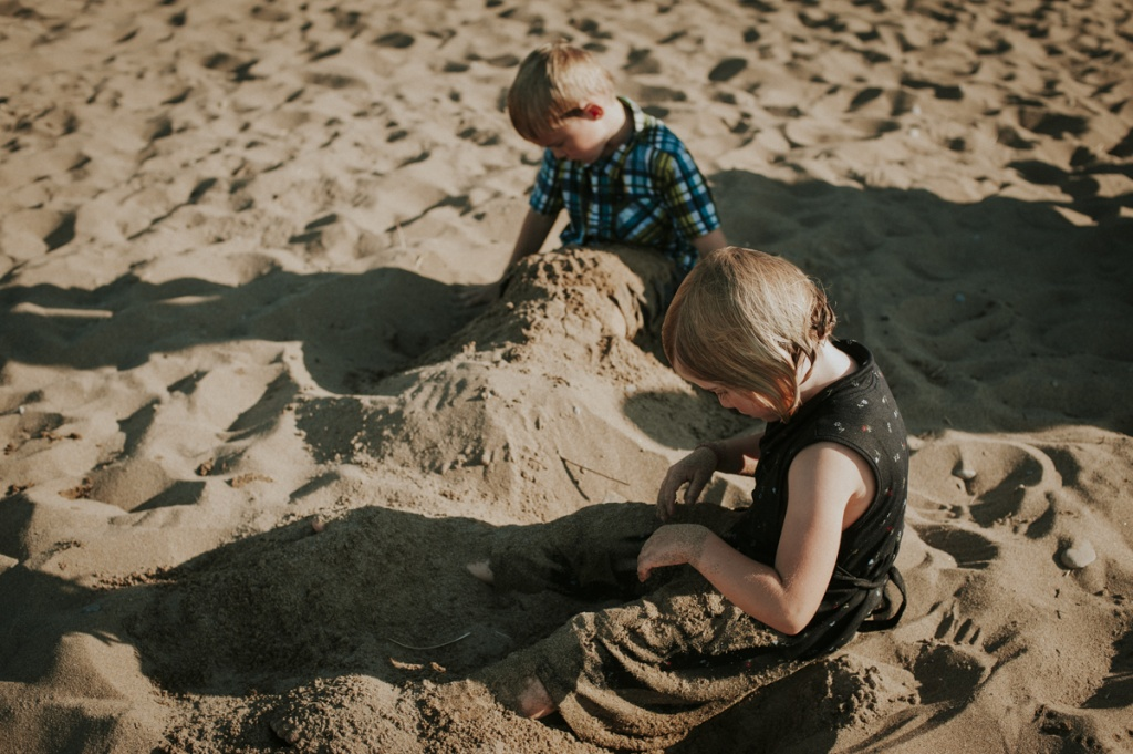 Kids playing in the sand. Family Photography by Sarah Tacoma.
