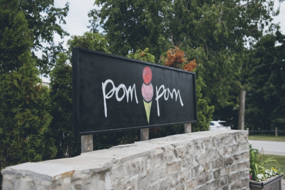 pom pom ice cream treat hut front signage.
