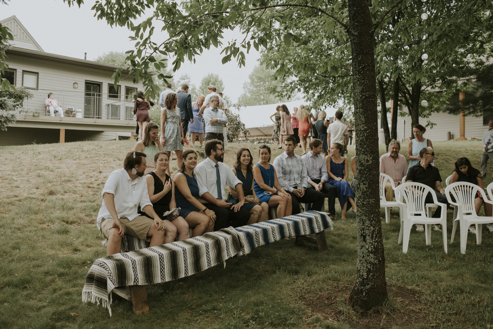 guests seated at outdoor forest wedding