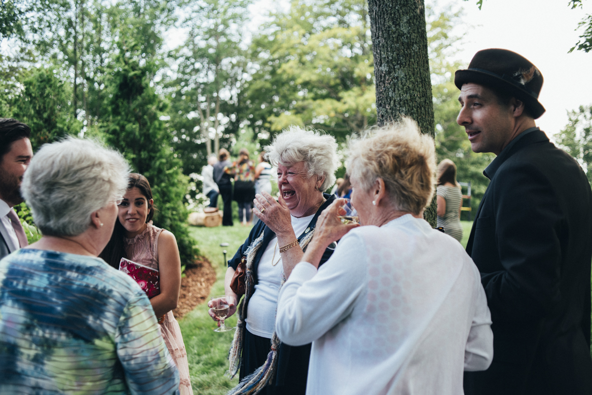 guests laughing at intimate backyard wedding
