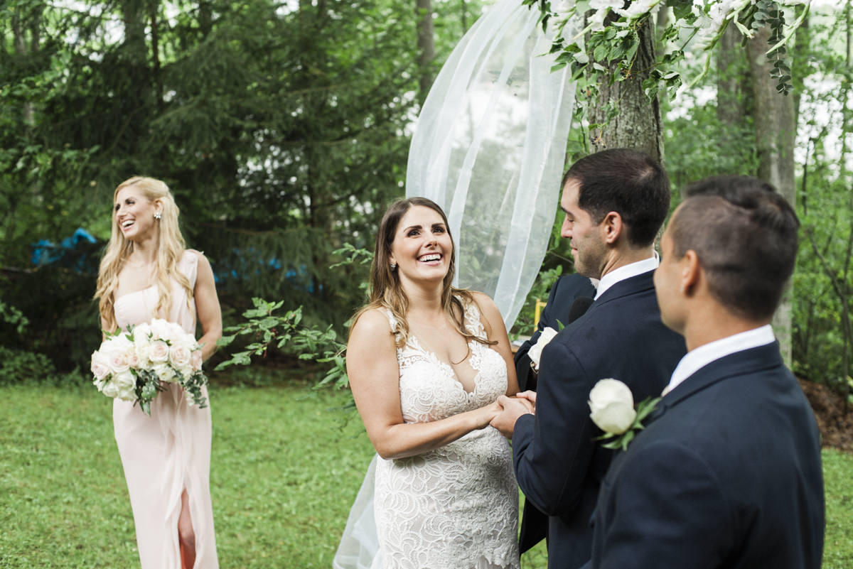 bride laughing at outdoor wedding