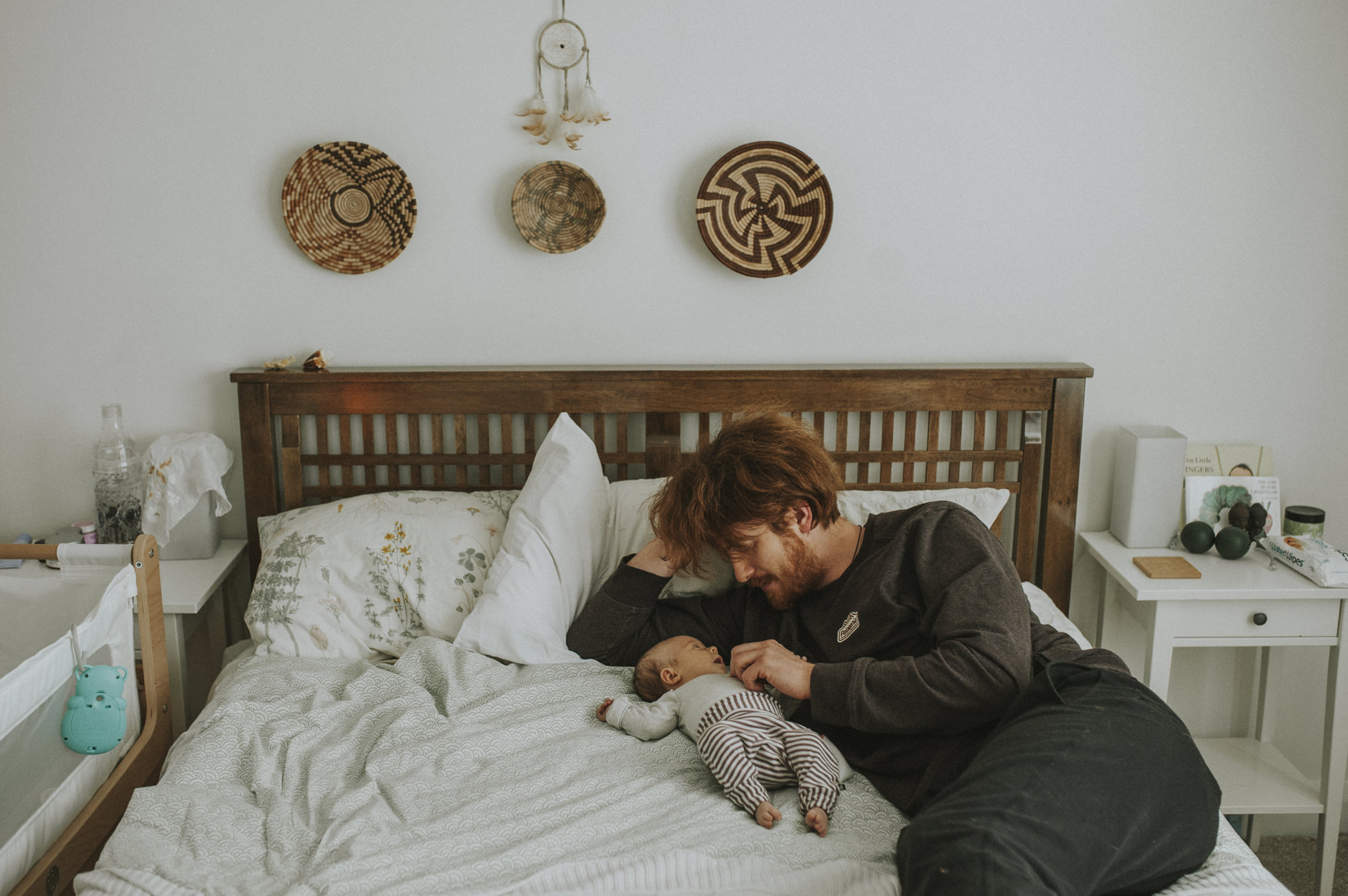 Dad and baby cuddling on bed