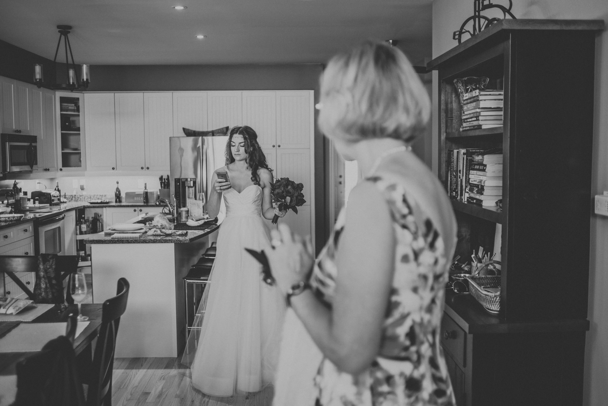 Bride checking her phone before ceremony