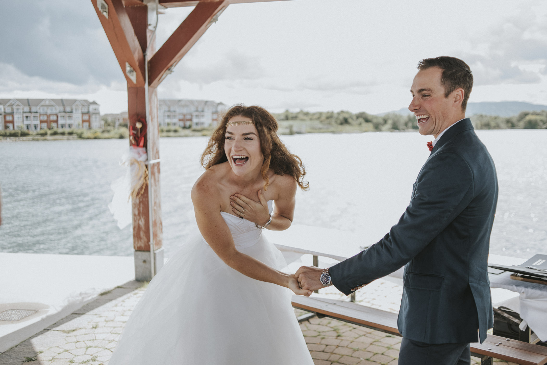 bride and groom laughing after first kiss