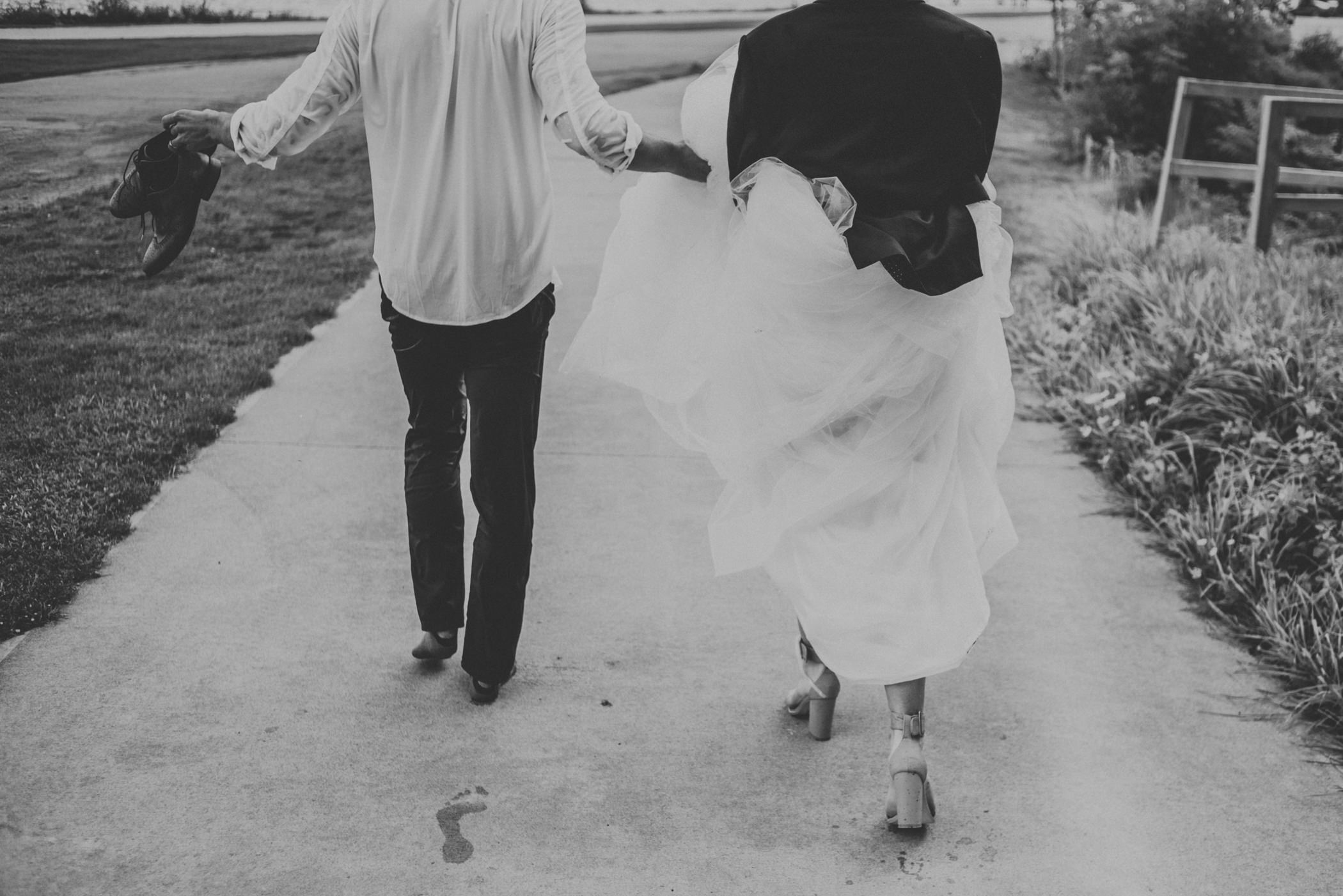bride and groom walking with wet clothes.