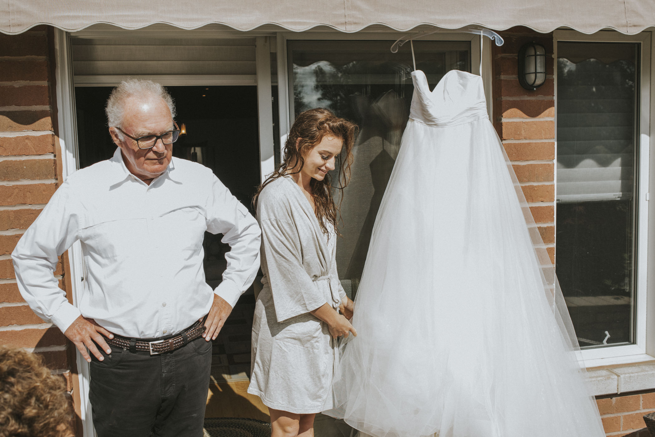 bride with hanging wet dress.