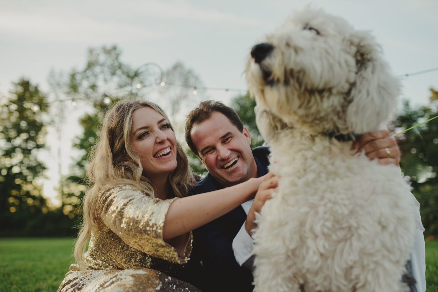 bride and groom with dog, family portrait