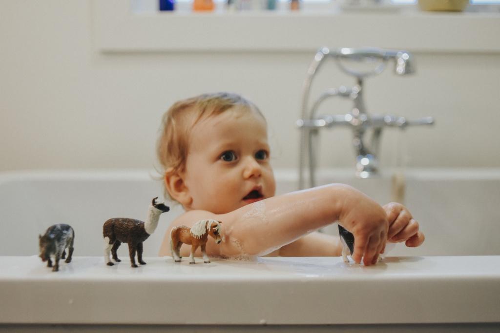 toddler in bath