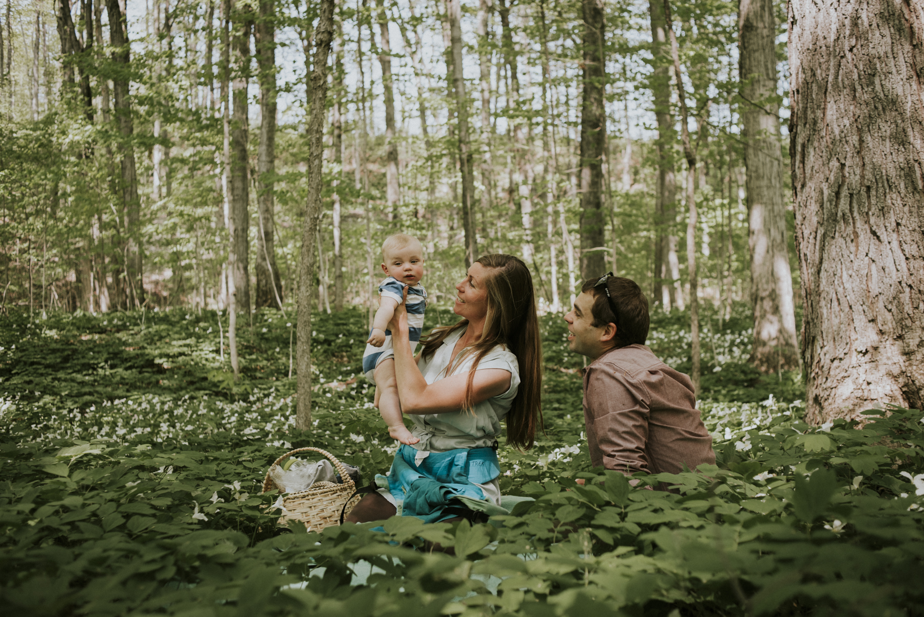 Family of three in Thornbury forest, Ontario.