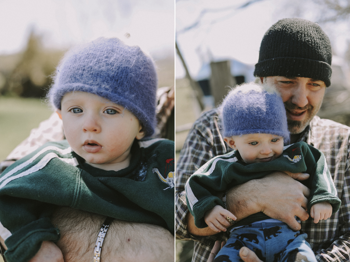 Father holding small son. Image by Sarah Tacoma.