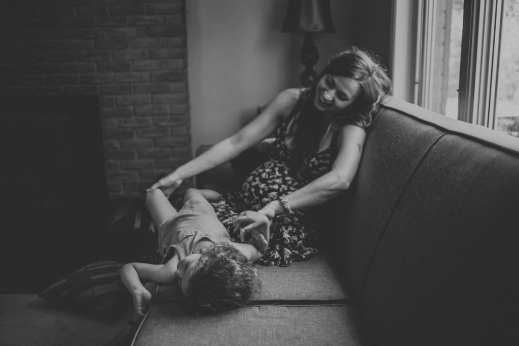 Pregnant woman on couch with her toddler. Black and White. Photo by Sarah Tacoma. Maternity Session.