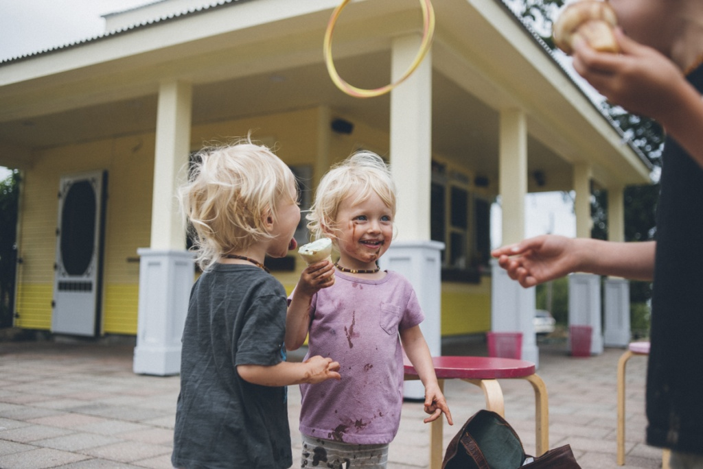 twin toddlers messy with ice-cream.