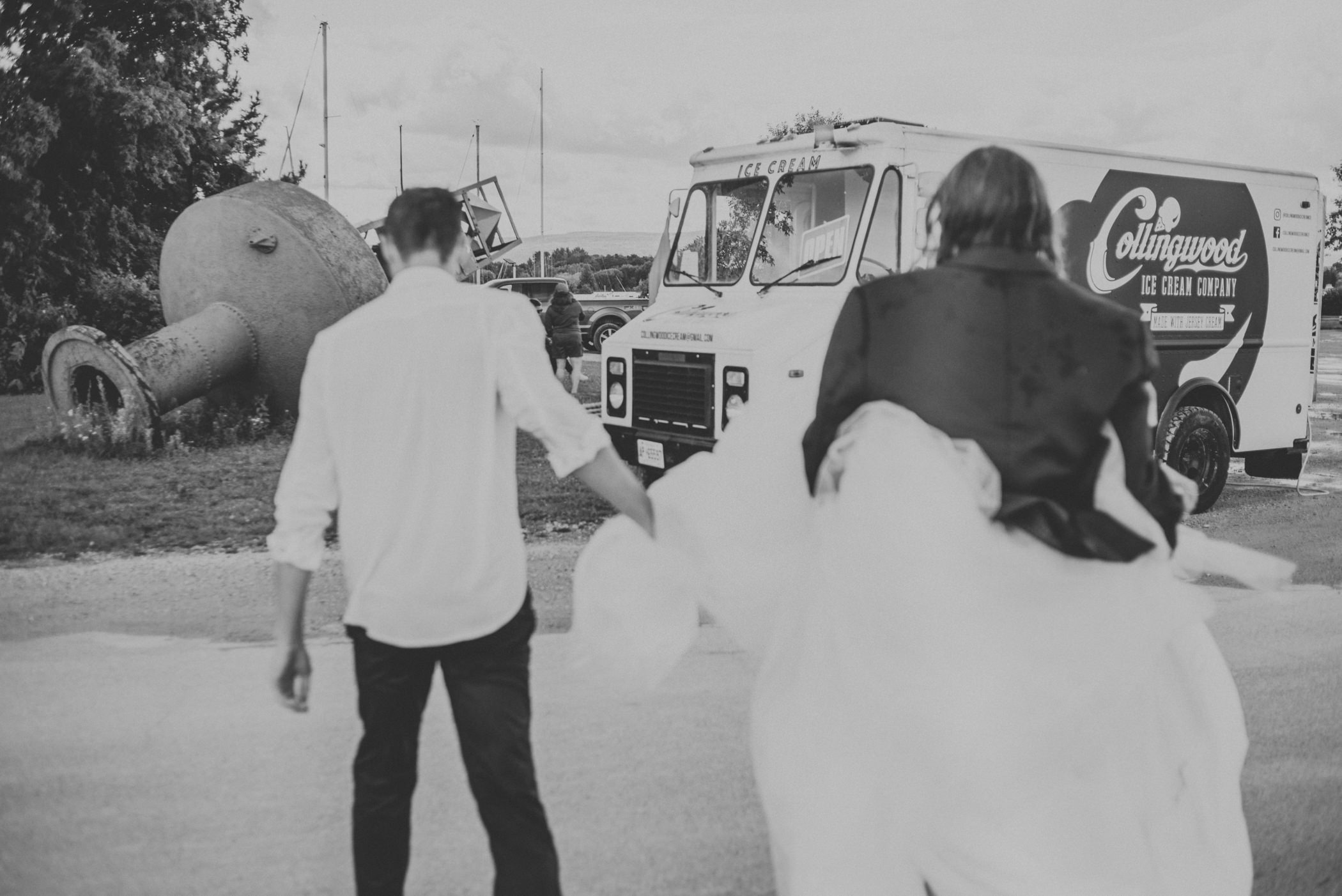 bride and groom getting scream from food truck.