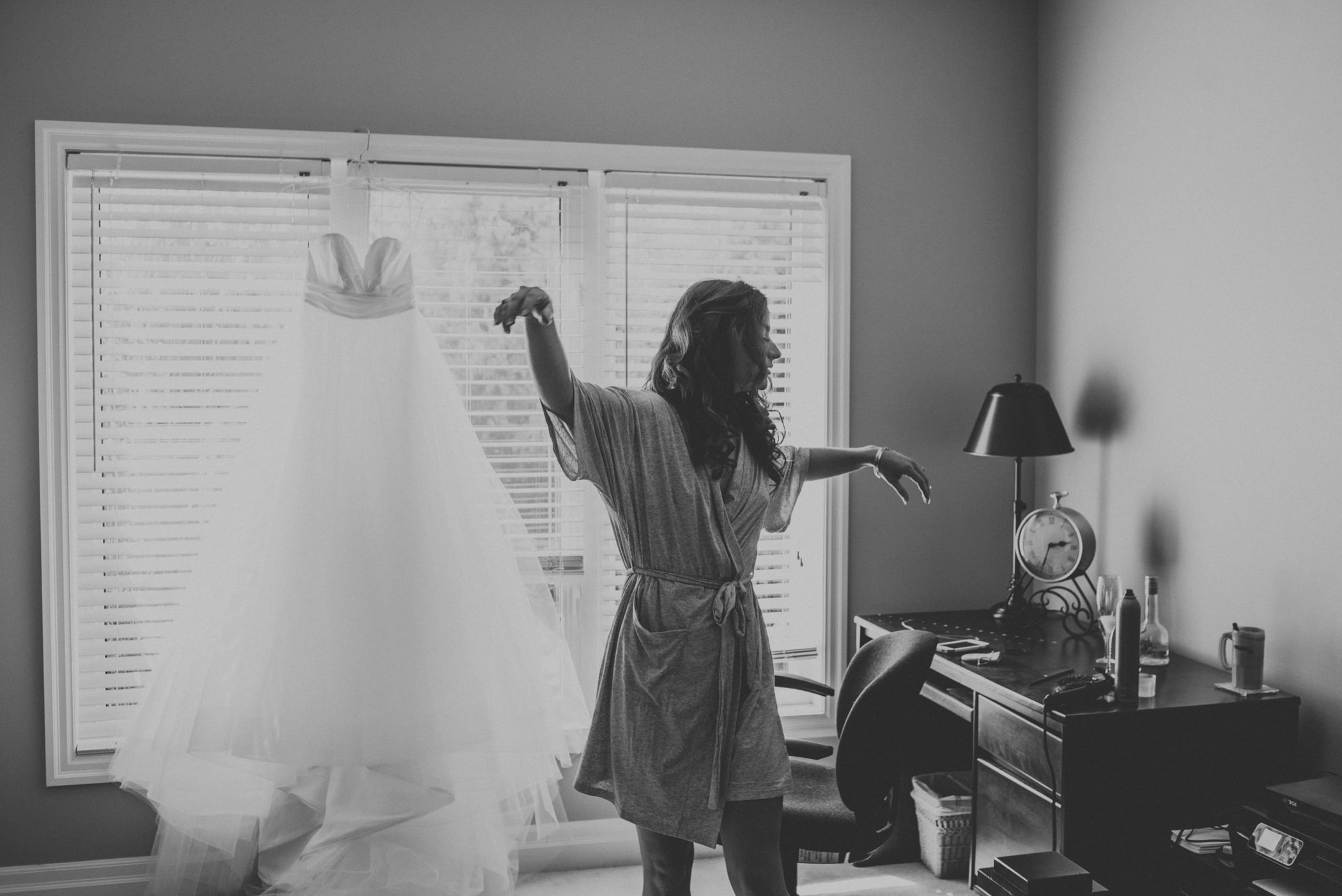 bride dancing in her robe