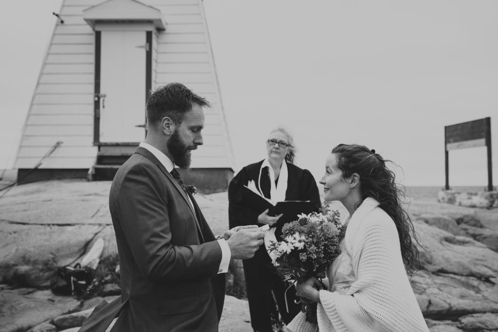 lighthouse elopement, Killarney, Ontario, reading vows, intimate moment