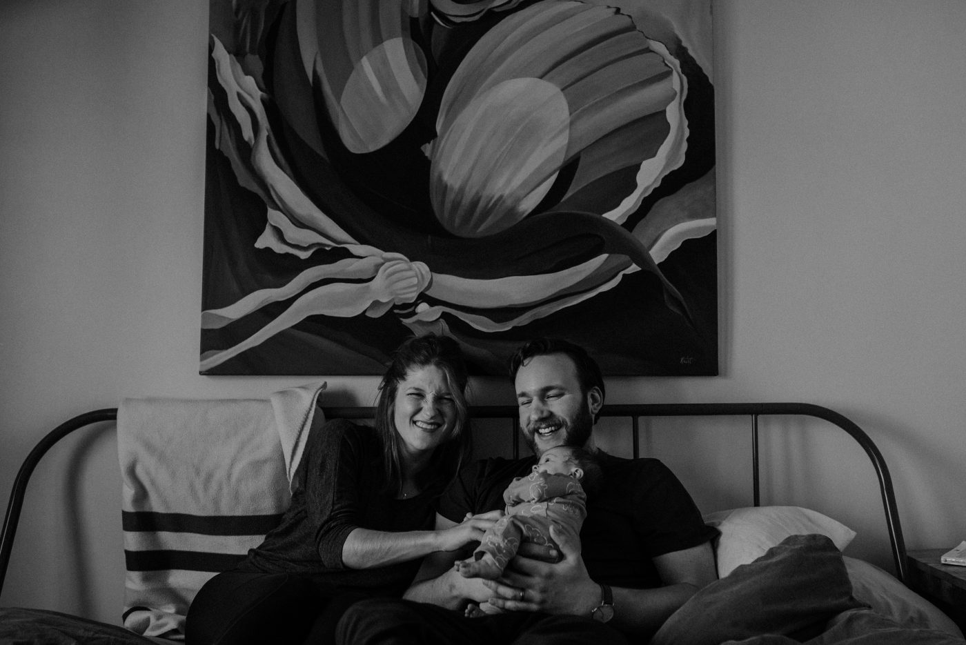 newborn family session, toronto. Family on bed together.